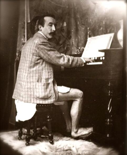 Artist Paul Gaugin plays a harmonium, circa 1895